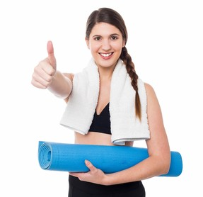 Smiling female trainer gesturing thumbs up